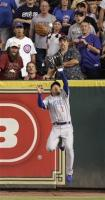 Kosuke Fukudome leaps up to try and catch a possible home run.jpg