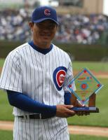 Kosuke Fukudome holds his Cubs Player of the Month award.jpg