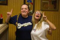 Two women baseball fans one roots for Brewers one for the Cubbies.jpg
