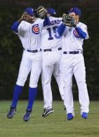 Cubs outfielders Soriano Edmonds and Fukudome celebrate.jpg