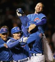 Cubs mob Soriano after his game winning hit vs the Dodgers.jpg