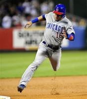 Aramis Ramirez flys around third base.jpg