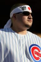 Cubs fan wears a Japanese head bandana.jpg
