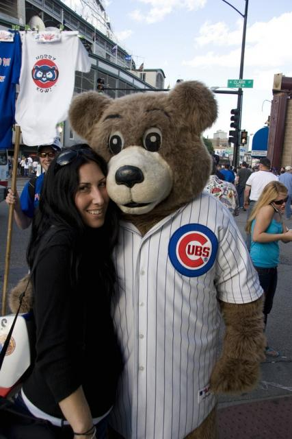 A fan with a Chicago Cubs Mascot.jpg