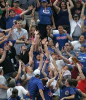Cubs fans try to catch a game winning home run ball.jpg