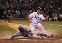 Mark DeRosa slides home safely.jpg