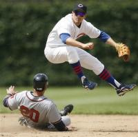 Ryan Theriot leaps in the air and throws to first.jpg
