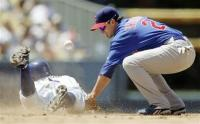 Ryan Theriot tries to tag Dodger player Juan Pierre.jpg