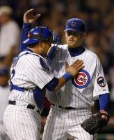 Ryan Dempster is congratulated by the catcher.jpg