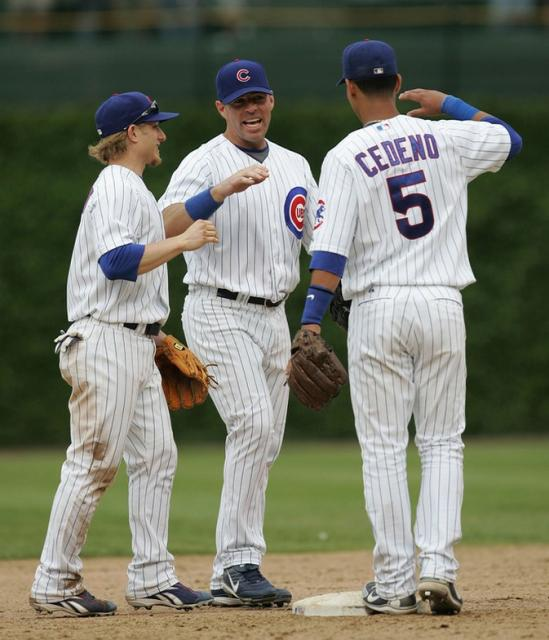 Cubs players Mike Fontenot Jim Edmonds and Ronnie Cedeno congratulate one another.jpg