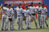 Cubbies congratulate one another on the victory.jpg