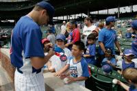 Ted Lily signs autographs for young fans.jpg