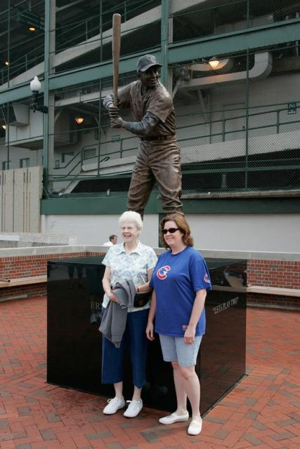 Cubs fans pose in front of the Ernie Bankes statue.jpg