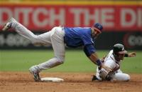 Mark DeRosa throws to first for the double play.jpg