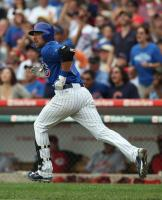 Mark DeRosa watches the flight of his home run.jpg