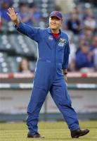 Cubs fan Astronaut Daniel Tani waves to the crowd.jpg