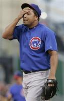 Carlos Zambrano wipes his forehand.jpg