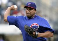 Carlos Zambrano delivers to home plate.jpg