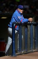 Lou Piniella looks on from the railing of the dugout.jpg