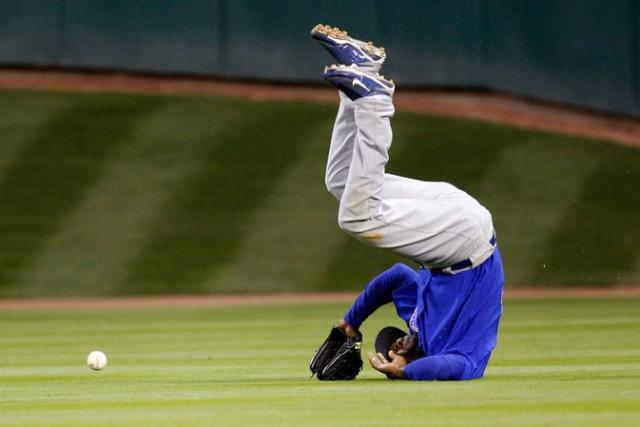 Milton Bradley flips over after missing a flyball.jpg