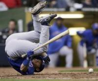 Koyie Hill falls to the ground after getting hit by a pitch.jpg