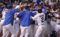The entire Cubs team converge on Aramis Ramirez for a game winning home run.jpg