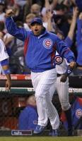 Carlos Zambrano runs out of the dugout in celebration.jpg