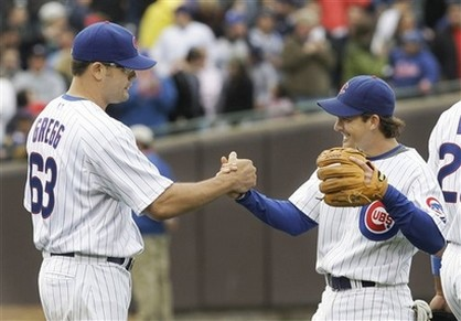 Kevin Gregg celebrates with Ryan Theriot after saving the game.jpg