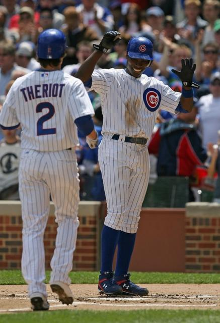 Alfonso Soriano smiles as he greets Ryan Theriot.jpg