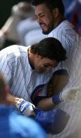 Ryan Theriot gets a body bump in the dugout.jpg