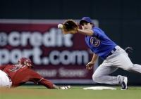 Ryan Theriot tries to tag Felipe Lopez on a pickoff attempt.jpg