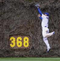Kosuke Fukudome leaps against the ivy to catch a long flyball.jpg