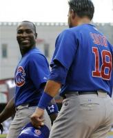 Alfonso Soriano smiles at Geovany Soto.jpg