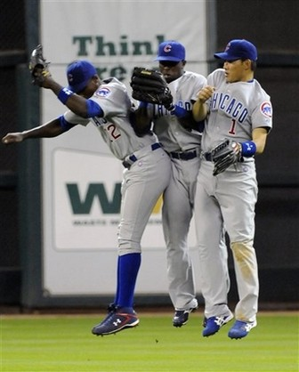 Cubs outfielders Alfonso Soriano, Joey Gathright, and Kosuke Fukudome do the celebration bump.jpg