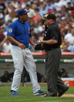 Carlos Zambrano chats with the home plate umpire.jpg