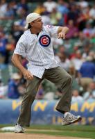 Cubs fan Kevin Nealon throws out the first pitch.jpg