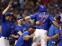 Ryan Theriot is mobbed by teammates after hitting the game winner.jpg