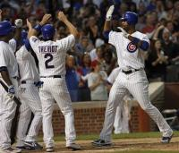 Derek Lee is congratulated by teammates after hitting a grand slam.jpg