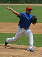 Carlos Zambrano pitches in a red cap.jpg