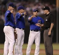Cubs players point and talk to the umpire.jpg