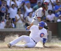 Derek Lee slides home safely.jpg