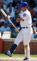 Kosuke Fukudome looks at his bat after striking out.JPG