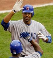 Derek Lee gets fives from Milton Bradley.JPG