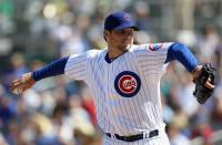 Randy Wells prepares to throw a fastball during Cubs 2010 Spring Training.JPG