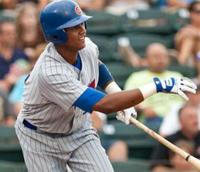 Starlin Castro moves out of the box after hitting the ball.JPG