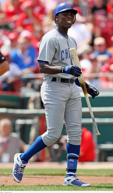 Alfonso Soriano clasps the barrel of his bat after striking out.JPG