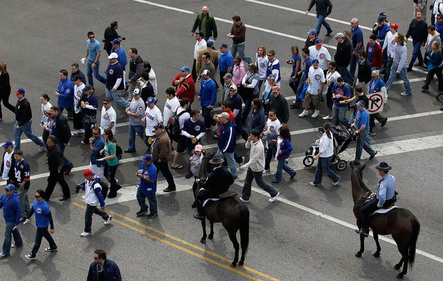 Cubs fans headed to Wrigley Field on opening day.JPG