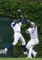 Alfonso Soriano jumps in front of Marlon Byrd to catch the ball.JPG