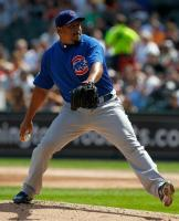 Carlos Zambrano strides and delivers a pitch.JPG