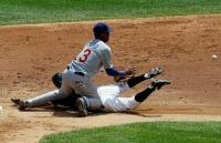 Starlin Castro tries to field the ball as the runner slides into second base.JPG